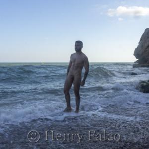 Naked boy on the beach